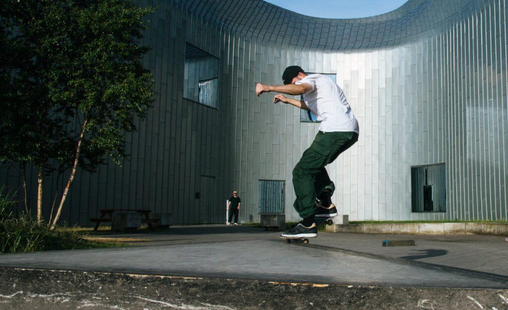 green cargo pants skateboarder
